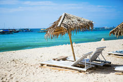 Deckchairs at the perfect white sand beach Royalty Free Stock Photo