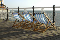 Deckchairs on pier. Traditional deckchairs on an English Victorian pleasure pier Royalty Free Stock Images
