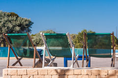 Deckchairs by the pool Stock Image