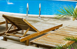 Deckchairs at the pool Stock Photography