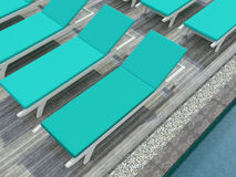 Deckchairs at the pool. Royalty Free Stock Photos