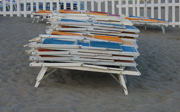 Deckchairs on the sand Stock Photo
