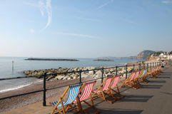 Deckchairs on seafront at Sidmouth in Devon Royalty Free Stock Images