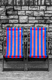 Deckchairs in seaside town Stock Photos