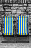 Deckchairs in seaside town Stock Photography
