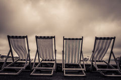 Deckchairs in seaside town Stock Image