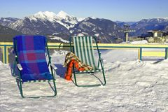 Deckchairs and snow. Deckchairs at the top of a  ski mountain in the sun Stock Images