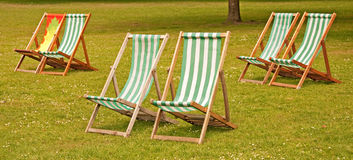 Deckchairs in St Jamess Park, London Stock Photos