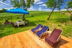Deckchairs in the summer garden Stock Photos