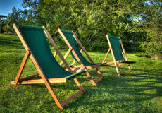 Deckchairs at sunset Stock Photography