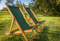 Deckchairs at sunset Royalty Free Stock Photography