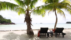 Deckchairs at tropical landscape view, Seychelles. Deckchairs at tropical landscape view at Prasin island, Seychelles stock footage