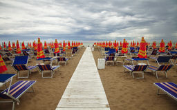 Deckchairs with umbrellas Stock Image