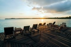 Deckchairs on a wooden bridge at sunset time in Kon Mak Stock Images