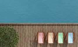 Deckchairs on a wooden pier Stock Photos