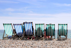 Deckchairs on Worthing beach Stock Images