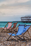 Deckchairs z zachodnim molem Zdjęcia Royalty Free