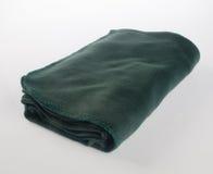 Decke oder weiche warme Decke auf Hintergrund Lizenzfreie Stockfotos