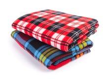 Decke, weiche warme Decke auf Hintergrund Stockfotos