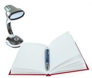 Decken Sie geöffnetes Buch mit Feder- und Tabellenlampe ab Stockbild