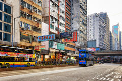 Decker buses and trams on the central streets in Hong Kong Royalty Free Stock Photo
