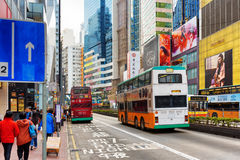 Decker buses and trams on the central streets of Hong Kong. Decker buses on the central streets. Hong Kong is a leading financial centre of the world Royalty Free Stock Image
