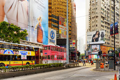 Decker buses and trams on the central streets of Hong Kong. Decker buses and trams on the central streets. Hong Kong is a leading financial centre of the world Royalty Free Stock Images