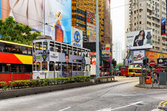 Decker buses and trams on the central streets of Hong Kong. Decker buses and trams on the central streets. Hong Kong is a leading financial centre of the world Royalty Free Stock Photography