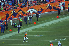 Decker streaks down the sideline. Eric decker down the side line for a long pass royalty free stock photo