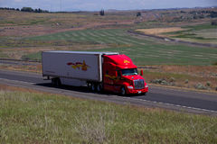 Decker Trucking/remolque rojo del blanco de Peterbilt foto de archivo