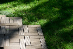 Decking on a lawn Stock Photography