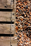 Decking and pebbles. At the beach stock images