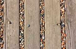 Decking and pebbles Stock Image