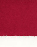 Deckled Paper Border on Red Stock Image