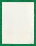 Deckled papier na zieleni zdjęcia royalty free