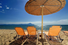 Decks and umbrella on beach Royalty Free Stock Images