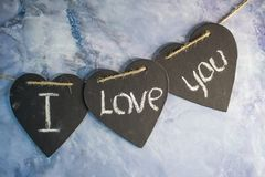 Declaração do amor escrita nos corações imagens de stock royalty free