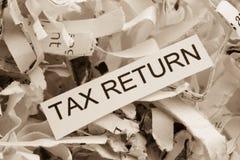 Declaración de impuestos de papel destrozada Fotografía de archivo libre de regalías