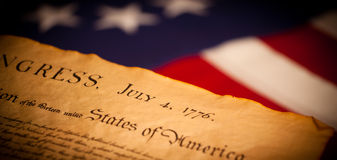 Declaration of Independence on flag background Stock Images