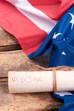 Declaration of the Independence of the United States. Close up Constitution of the USA and USA flag on rustic wooden boards, vertical image Royalty Free Stock Images