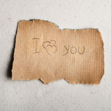 Declaration of love on sheet. I love you. The message on fragmentary sheet Stock Image