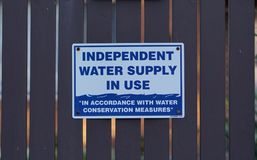 Chelsea, VIC / Australia - Aug 1 2018: Independent water supply in use signage stock image