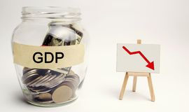 Decline and decrease of GDP - failure and breakdown of economy and finances leading to financial crisis and trouble. Drop in gross. Domestic product. Bank with royalty free stock photos