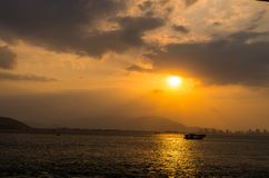 Decline in East sea. Vietnam,East sea,lonely boat,decline over mountains stock photos