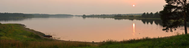 Decline over the lake. Large-format panorama of a sunset over the lake Stock Photography