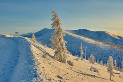 Decline on pass. Winter. Evening. Kolyma IMG_9584 royalty free stock image