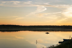 Decline on the river. The fisherman on the river on a sunset Stock Photography