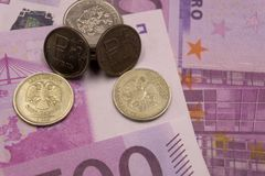 The decline of the ruble to the Euro Coins on the background of 500 euros . stock photo