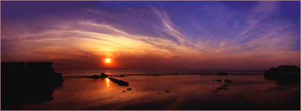 Decline at the sea. Dawn or decline above the sea? It is photographed in Акко. Israel Stock Photos