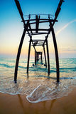 Decline on the seashore. The destroyed pier stock photo